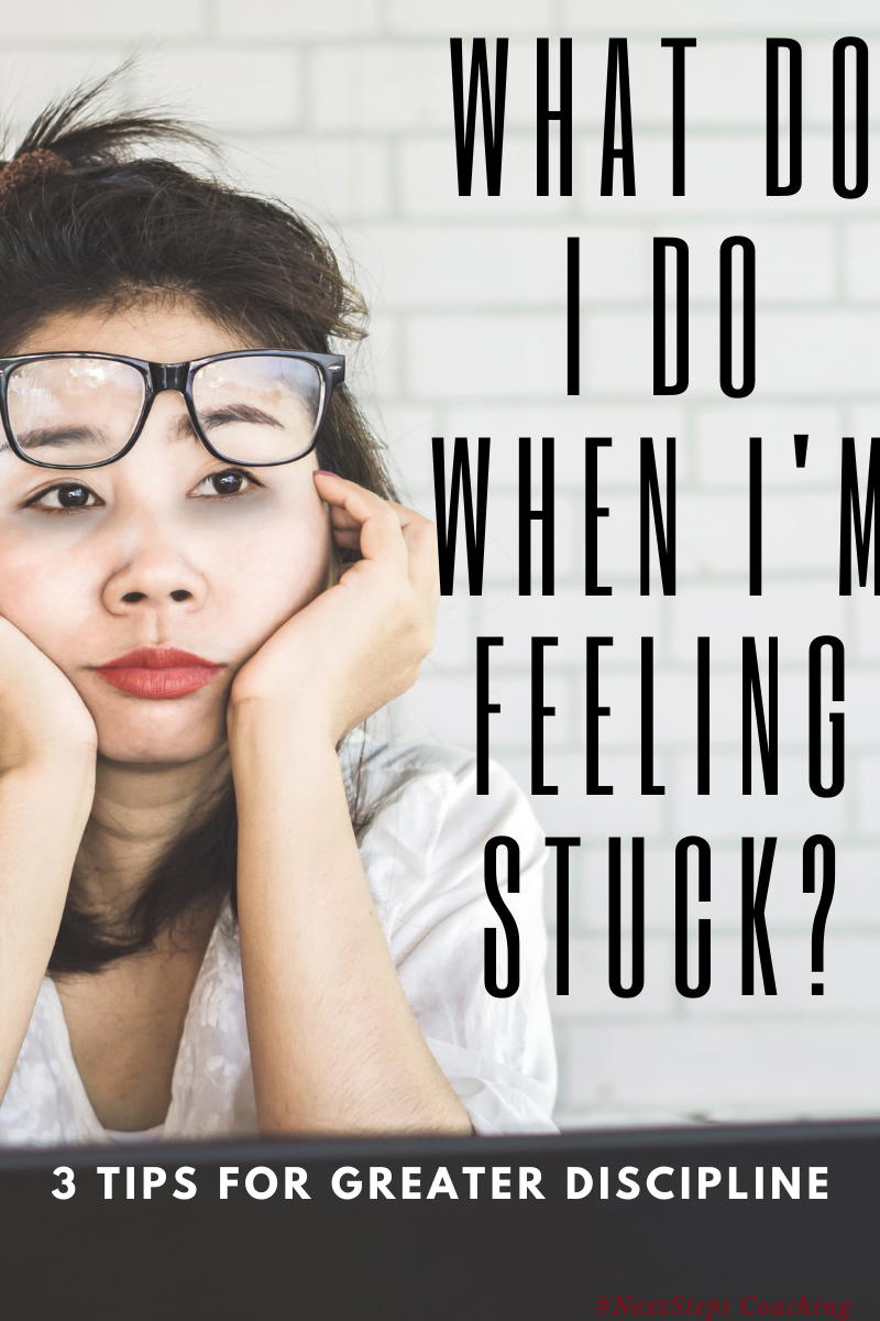 Frustrated woman with glasses pushed up her forehead asking what do I do when I'm feeling stuck?
